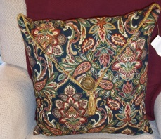 Morene made this very nice pillow from an rethrifted pillow, fabric and trim.