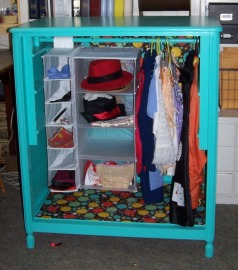 Sue remodeled an old cupboard into a dress up station for her grandchildren. The cupboard, clothes rod and hanging organizers all were Community Thrift Shop purchases.