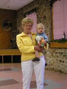 Sue Harris is holding her grandson Jackson Blum.