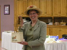Mary Bentley show off her favorite Thrift shop purchases, a very nice straw bag and cute hat.