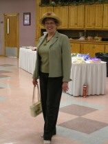 Community Thrift Shop manager, Mary Bentley is modeling her re-thrifted blouse, jacket, and slacks from the shop.