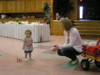Sarah Blum offers a little walking assistance to 1 year old daughter Lilah...